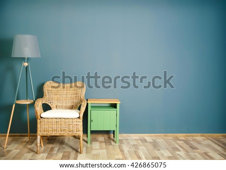 Room interior with wicker chair on dark grey wall background #426865075