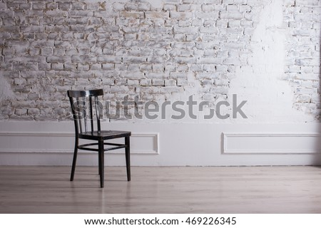 ROOM minimalism, chair in the room, the background STONE WALL, MODERN ROOM. DECORATIVE BRICK WALL WHITE AND BLACK CHAIR CHAIR. Modern living room, light background. Living room, brick wall, NEW ROOM