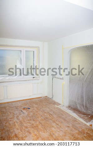 Room renovation. White room repair with dirty floor.