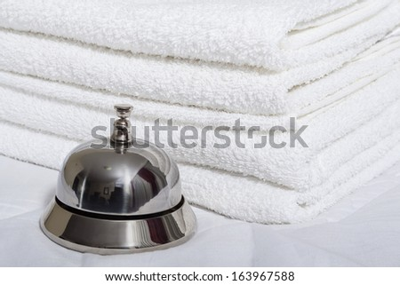 Room service bell and towels