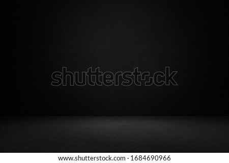 Room with black concrete wall background.