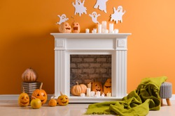 Room with fireplace decorated for Halloween party