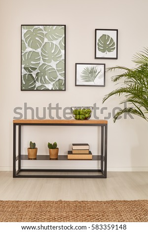 Room with plant motives and minimalistic rack