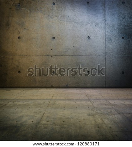 Room with smooth concrete wall and floor.