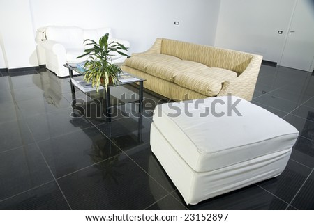 room with tiled floor and sofa