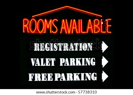 Rooms Available neon sign with parking directions at a hotel