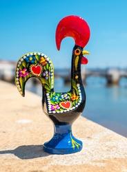 Rooster of Barcelos (Galo de Barcelos) on a quay of Gilao River. Tavira, Algarve, Portugal