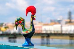 Rooster of Barcelos (Galo de Barcelos) on a quay of river Gilao. Tavira, Algarve, Portugal