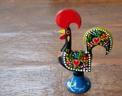 Rooster of Barcelos (Rooster of Barcelos) on a wooden table. with space for text