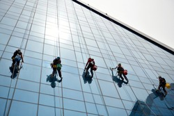 Rope access cleaners on a building
