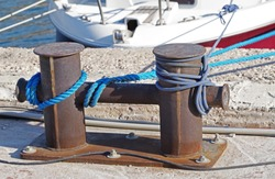 rope and old Marina bollard on moorage