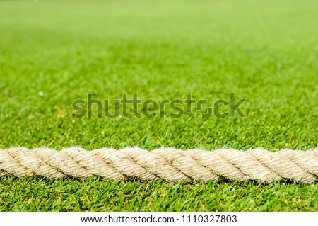 Rope at the boundary of a cricket pitch #1110327803