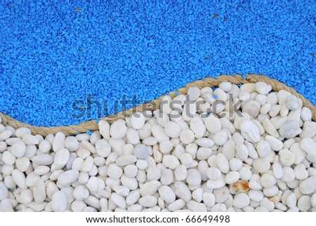 Rope between white and blue stones for background