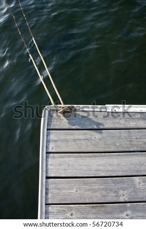 Rope cleated to dock