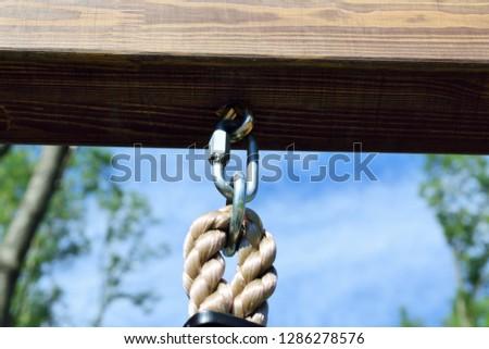 rope hangs on a metal bracket #1286278576