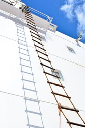 Rope ladder on board ship on accommodation block