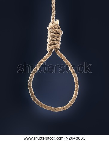 Rope noose with hangman's knot hanging in front of blue background.