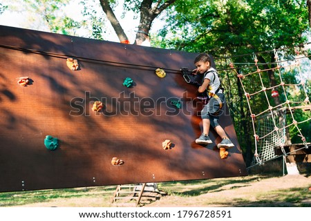 Rope Park. The kid passes the obstacle in the rope Park ストックフォト ©