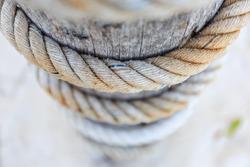 rope tied wood pole