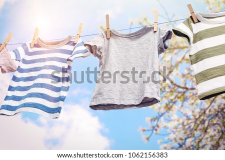 Photo of  Rope with clean clothes outdoors on laundry day