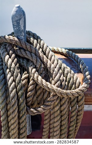ropes braided in bays on an ancient sailing vessel, vertical, selected focus
