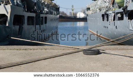 ropes crosswise at the background of two ships and canal. #1066552376