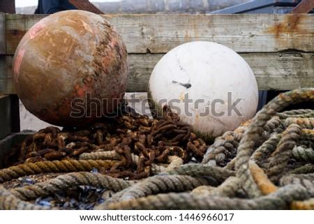 Ropes, fishing tackle, and buoys. #1446966017