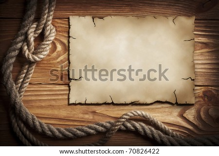 Ropes, old paper on a wooden background