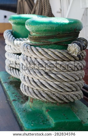 ropes on an ancient sailing vessel, vertical
