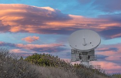 ROSA Radar Dish under a beautiful sunset along the Florida Coast near Patrick Air Force Base, now a Space Force Base, with dramatic clouds and no people