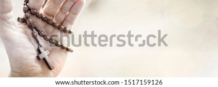 Rosary beads and crucifix cross in hand background with copy space #1517159126