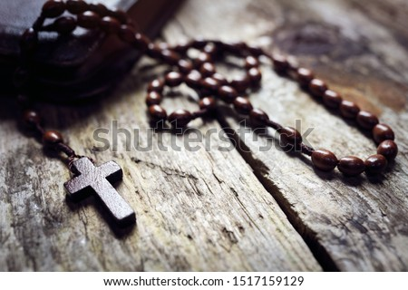 Rosary beads and crucifix cross on holy bible background #1517159129