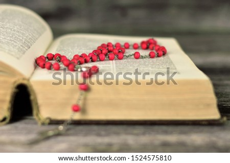 Rosary beads and holly bible #1524575810