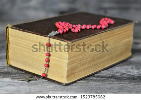 Rosary beads on holly bible   #1523785082