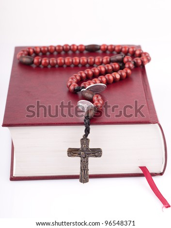 rosary on holly bible