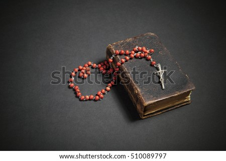 Rosary on the old Bible  #510089797
