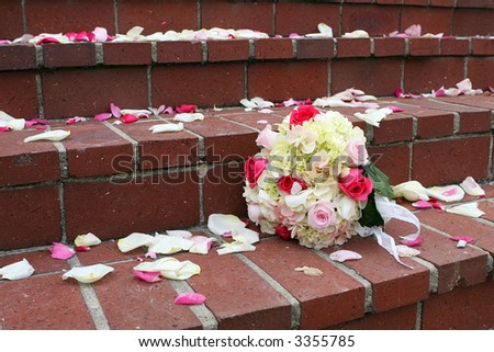 Rose and hydrangea bouquet on church steps.