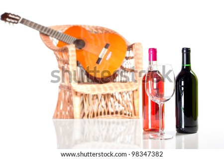 Rose and red wine bottle more a glass with a guitar on background