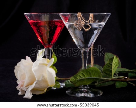 Rose and two glasses of cocktails on a white background