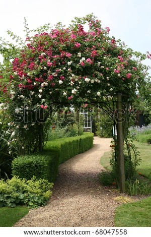 Rose Arch in English Country Garden - stock photo