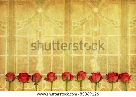 rose blossoms on a desaturated background from art deco windows