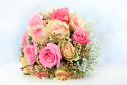 Rose bouquet with white-blue blurred background