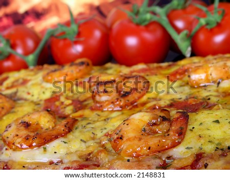 Rose colored garden prawns marinated in wine on healthy tomato pizza, macro, closeup with copy space