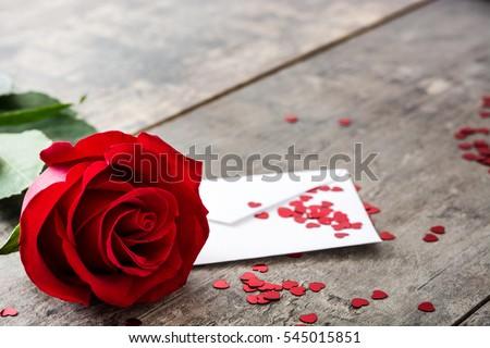 Rose, envelope and hearts on wooden background   #545015851