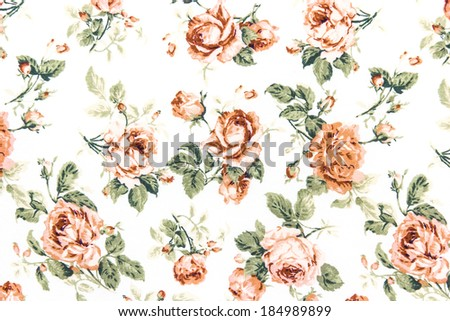 Rose Fabric background Fragment of colorful retro tapestry textile pattern with floral ornament useful as background