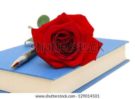 rose flower and blue book isolated on white background