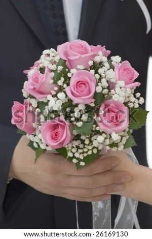 stock photo Rose flowers wedding bouquet hands of bride and groom