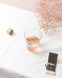 Rose Glass Styled on Table Top with Pink Baby's Breath