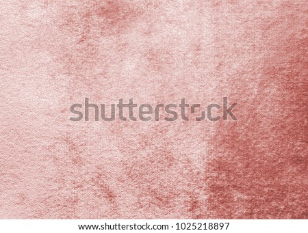 Rose gold pink velvet background or velour flannel texture made of cotton or wool with soft fluffy velvety satin fabric cloth metallic color material