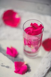 Rose petals in a bowl of water